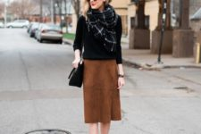 17 brown suede wrap skirt, a black sweater and a blanket scarf