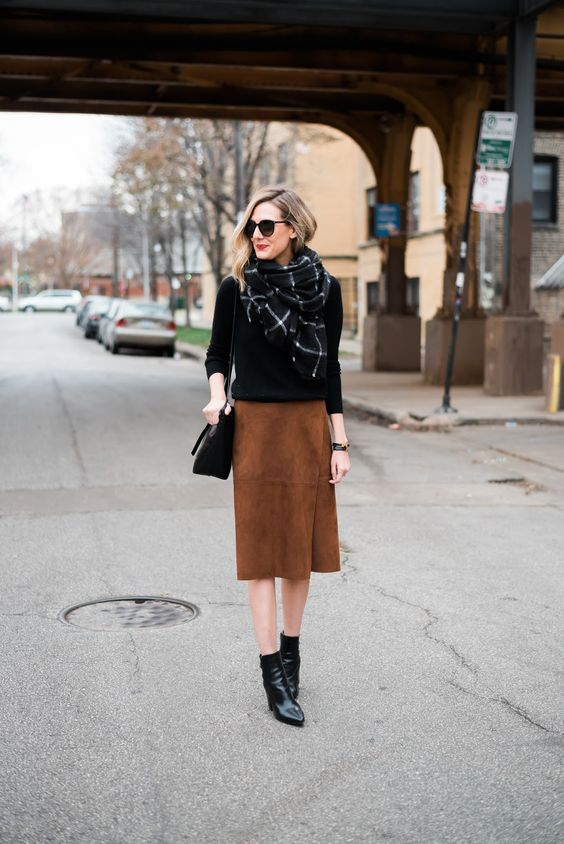 brown suede wrap skirt, a black sweater and a blanket scarf
