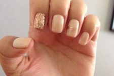 18 neutral nails with a gold glitter accne tone and gold stripes