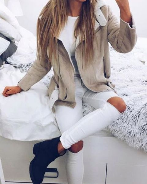 ripped white jeans, a neutral jacket with faux fur and boots
