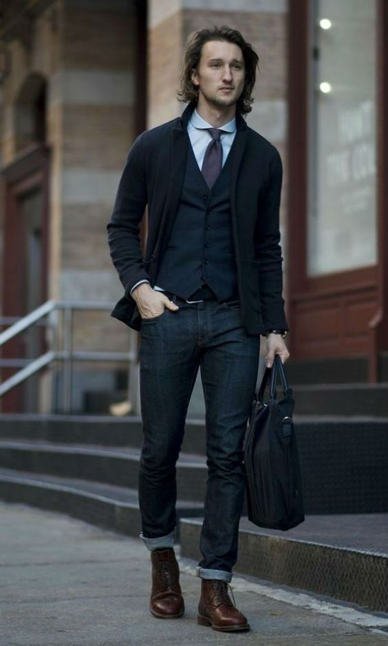 dark denim, a black vest and cardigan and a tie