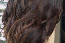 19 dark wavy hair with sutble caramel highlights