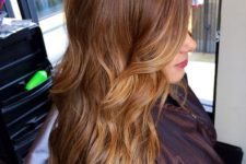 20 chestnut hair with lighter honey tones to frame the face