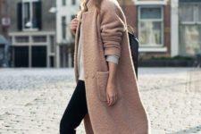 20 white Converse, black jeans, a blush coat and a beanie