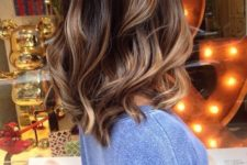 21 deep brown with caramel balayage highlights to create a dimension