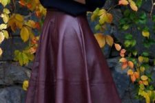21 high low burgundy leathe rskirt, a black sweater, a plaid blanket scarf and heels