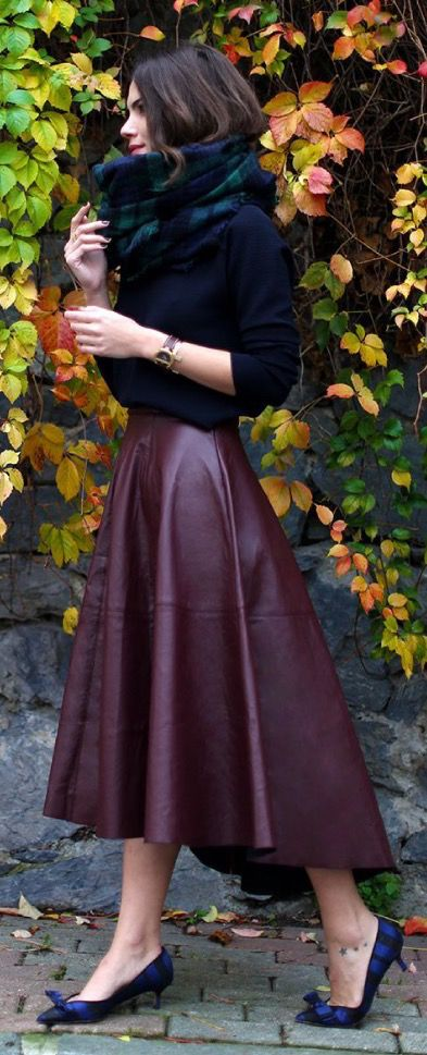 high low burgundy leathe rskirt, a black sweater, a plaid blanket scarf and heels