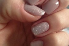 21 neutral manicure with two glitter accent nails