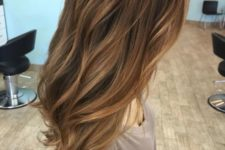 22 dark and warm brown hair with blonde caramel highlights