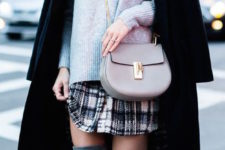 23 over the knee boots, a plaid skirt, a grey sweater and a black coat