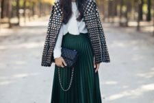 23 studded leather jacket, a plissed midi skirt in dark green, a white collared shirt, black ankle boots