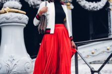 24 red pleated midi skirt, a black turtleneck, a white bomber jacket and heels
