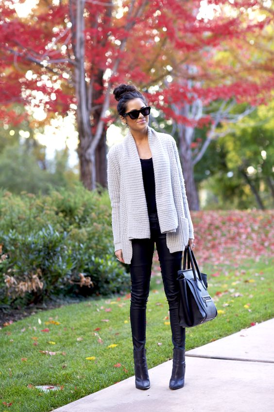 black boots, a neutral oversized cardigan and a black top