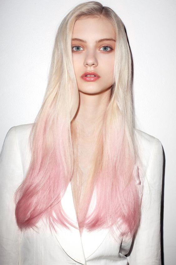 blond hair with pastel pink balayage looks very unusual