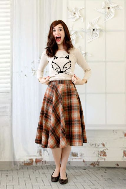 plaid midi skirt, a printed shirt and flats for a comfy casual look