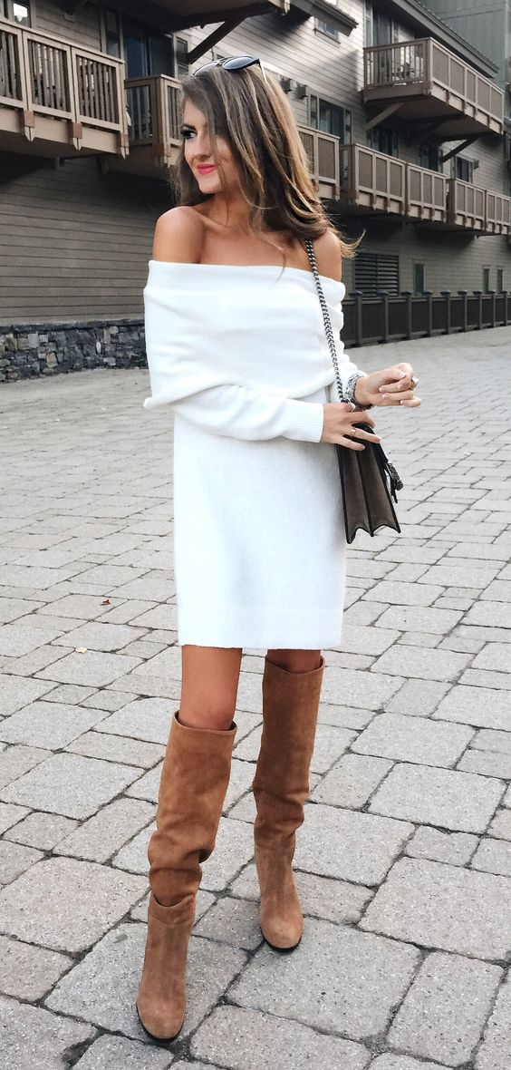 white off the shoulder sweater dress and tan suede tall boots