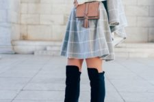 26 white turtleneck sweater, a windowpane skirt and suede keen boots
