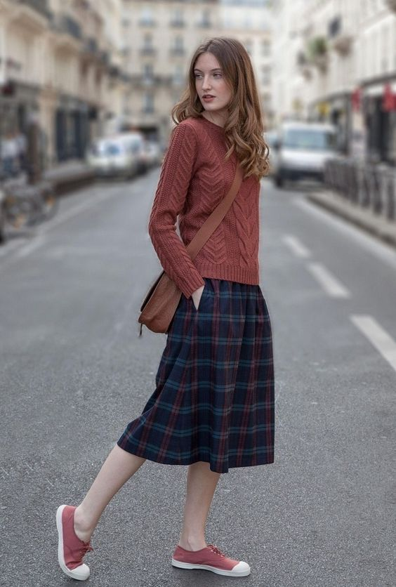 Picture Of plaid midi skirt, a red brown sweater and sneakers