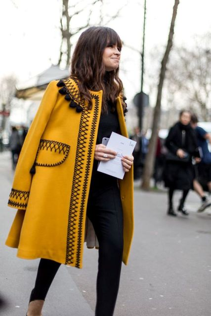 Decorated coat with black shirt and trousers