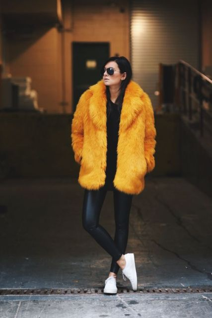 Fur coat with leather skinny pants and white sneakers