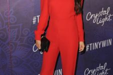 Red jumpsuit with black clutch and pumps