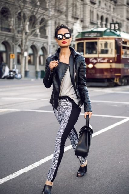 With beige shirt black leather jacket and leather bag