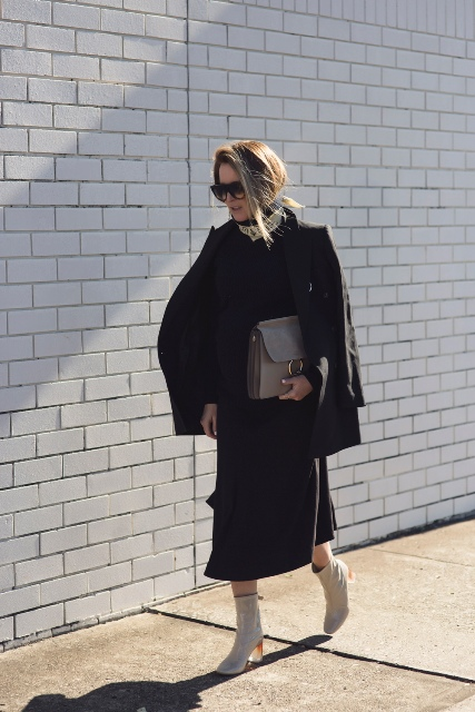 With black classic jacket, midi skirt and clutch
