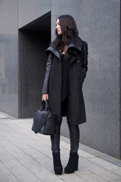 With black coat, leather pants and bag