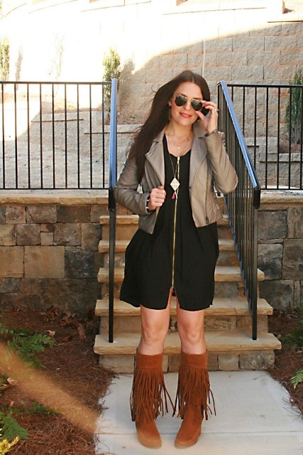With black dress and leather neutral color jacket
