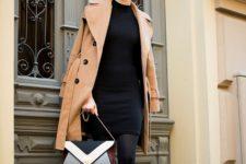 With black dress, camel coat and geometric print bag