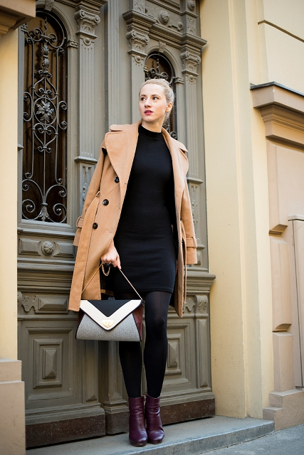 With black dress, camel coat and geometric print bag