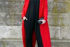 With black jumpsuit and neutral heels