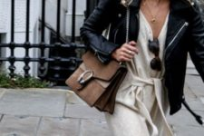 With black leather jacket and chain strap bag