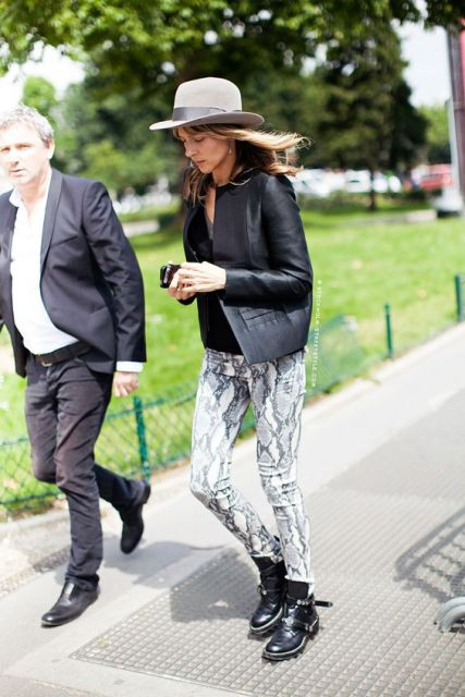 With black leather jacket, wide brim hat and ankle boots