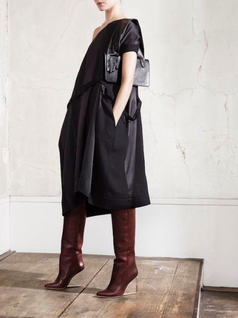 With black midi dress and mini bag