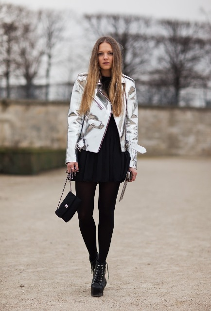 With black mini dress, tights, platform ankle boots and mini bag