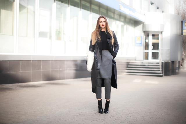 With black shirt, gray skirt and pants