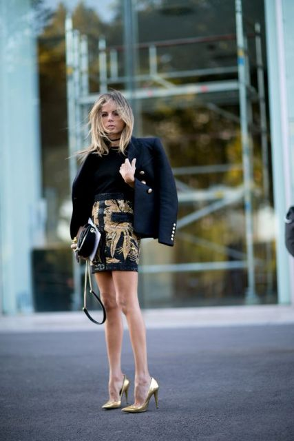 With black shirt, navy blue jacket and metallic pumps