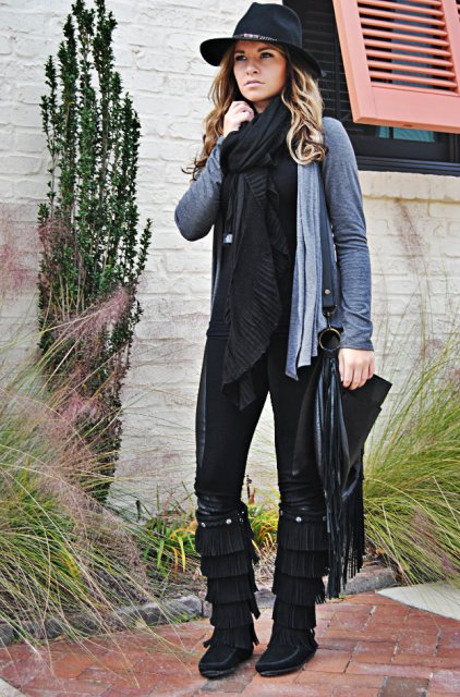 With black shirt, pants, hat and oversized scarf