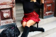 With black shirt, red skater skirt and big leather bag
