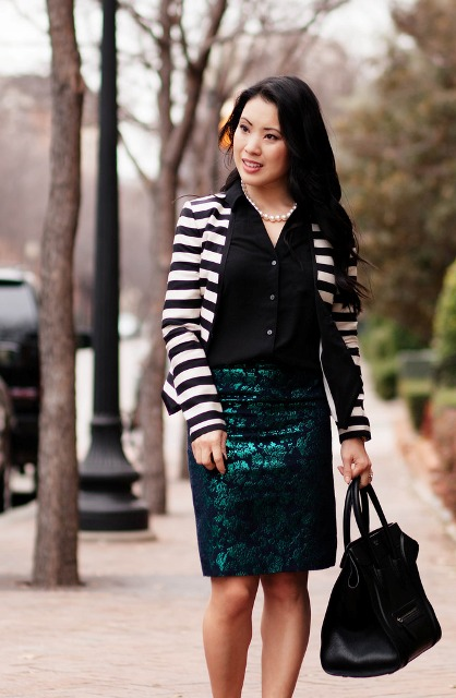 With black shirt, striped jacket and bag