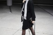 With black skirt, black shirt and white scarf