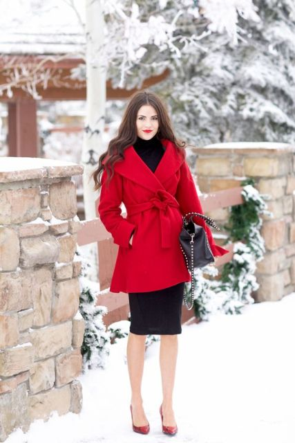 With black turtleneck, knee-length midi skirt and red pumps