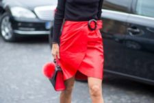 With black turtleneck, red skirt and mini bag