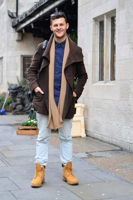With brown coat, blue shirt and oversized scarf