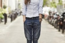 With button down shirt, bow tie and cuffed jeans