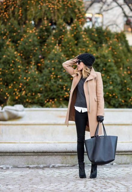 With camel coat, skinnies and tote
