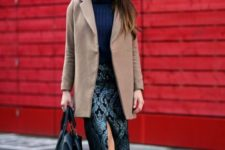 With camel mini coat, blue sweater and black bag