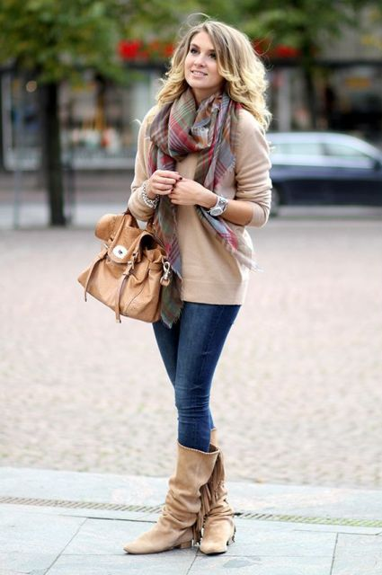 With camel sweater, plaid scarf and jeans