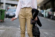 With camel trousers, classic white shirt and black bag
